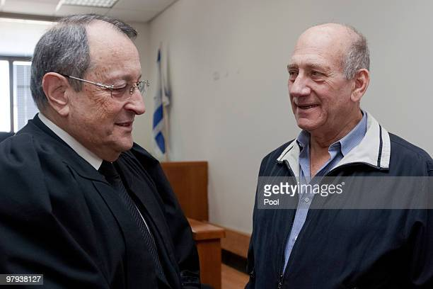 Former Israeli Prime Minister Ehud Olmert speaks with his attorney during his trial at the District Court on March 22, 2010 in Jerusalem, Israel....