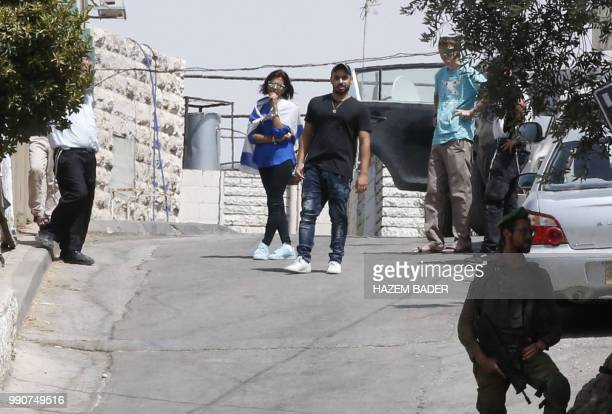 Former Israeli soldier Elor Azaria stands as he visits friends in the settlement of Tal Rumeida in the occupied West Bank city of Hebron on July 3...