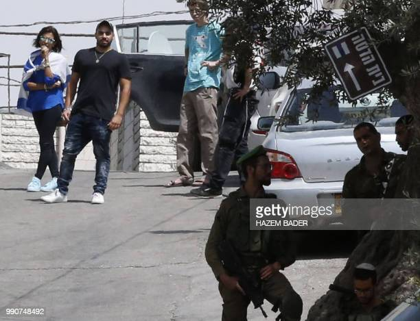 Former Israeli soldier Elor Azaria stands next to a woman as he visits friends in the settlement of Tal Rumeida in the occupied West Bank city of...