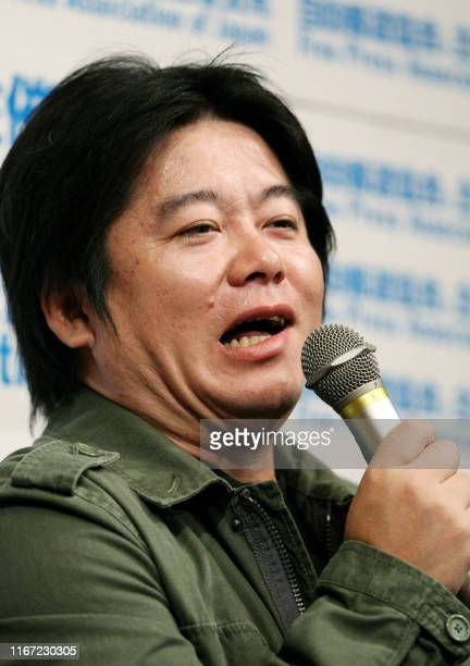 Former IT tycoon Takafumi Horie founder of Japan's top Internet empire Livedoor speaks to reporters in Tokyo on April 26 2011 after the Supreme Court...