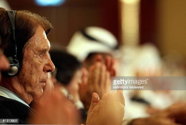 Former Italian football coach Cesare Maldini applauds as he attends the opening session of the third Dubai International Sports Conference on May 31...