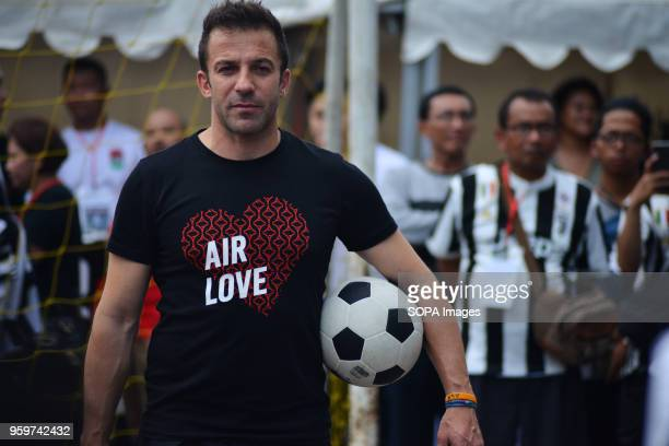 Former Italian football player Alessandro Del Piero seen posing for the picture after playing with young football players in Medan Del Piero visited...