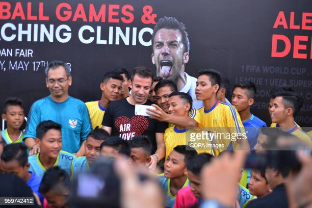 Former Italian football player Alessandro Del Piero seen taking a selfie with young football players in Medan Del Piero visited Medan to promote...