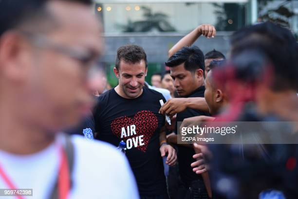 Former Italian football player Alessandro Del Piero seen walking through the crowd after playing with young football players in Medan Del Piero...