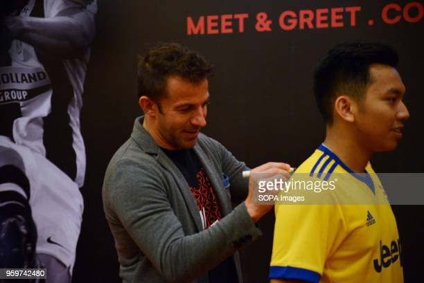 Former Italian football player Alessandro Del Piero seen writting an autograph on the back of a young football player in Medan Del Piero visited...