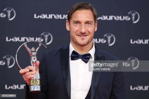 Former Italian football player and AS Roma forward Francesco Totti poses with his Laureus academy exceptional achievement award during the 2018...