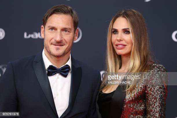 Former Italian football player Francesco Totti and his wife Italian TV host and model Ilary Blasi arrive for the 2018 Laureus World Sports Awards...