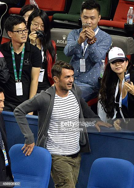 Former Italian football player Paolo Cesar Maldini leaves after watching Serbia's Novak Djokovic play against Mikhail Kukushkin of Kazakhstan in the...