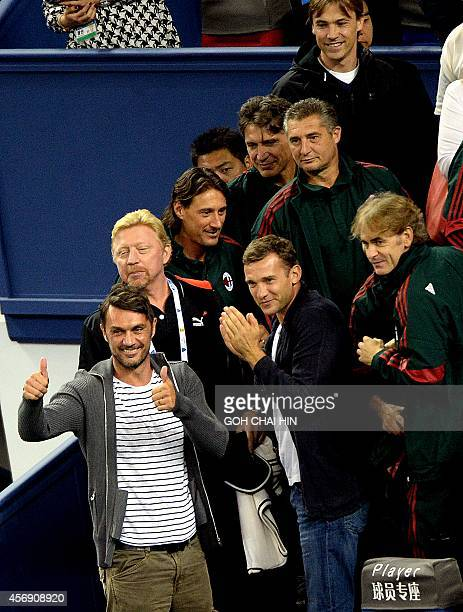 Former Italian football player Paolo Cesar Maldini together with former German tennis star Boris Becker and former players of the AC Milan team cheer...