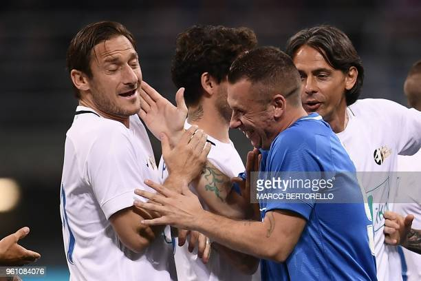 """Former Italian football players Francesco Totti and Antonio Cassano joke during the """"Notte del Maestro"""" , a football match celebrating the end of..."""