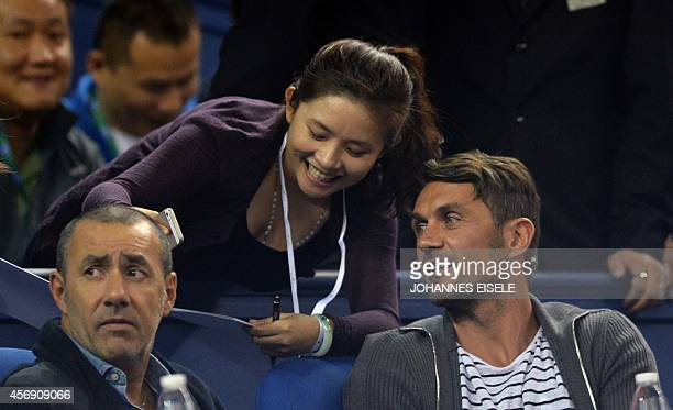Former Italian footballer Paolo Cesare Maldini poses for a picture with a fan during the men's singles third round match of Serbia's Novak Djokovic...