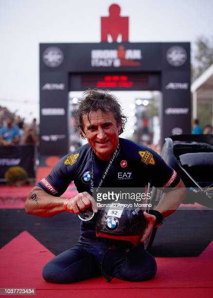 Former Italian Formula One and athlete Alex Zanardi celebrates after beating a new record during the biking course of Ironman Emilia Romagna on...