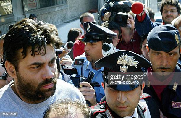 Former Italian hostage Maurizio Agliana is escorted by the police as the three Italian hostages freed yesterday by coalition forces in Iraq have been...