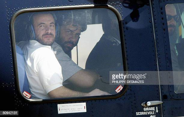 Former Italian hostages Umberto Cupertino and Maurizio Agliana sit in a helicopter 09 June 2004 after arriving at Rome's Ciampino airport with...