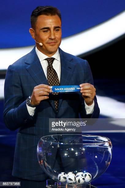 Former Italian international Fabio Cannavaro shows the ticket of Saudi Arabia during the 2018 FIFA World Cup Russia Final Draw in the State Kremlin...