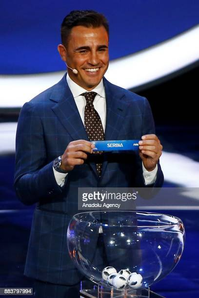 Former Italian international Fabio Cannavaro shows the ticket of Serbia during the 2018 FIFA World Cup Russia Final Draw in the State Kremlin Palace...