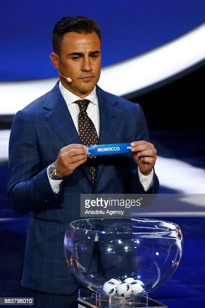 Former Italian international Fabio Cannavaro shows the ticket of Morocco during the 2018 FIFA World Cup Russia Final Draw in the State Kremlin Palace...