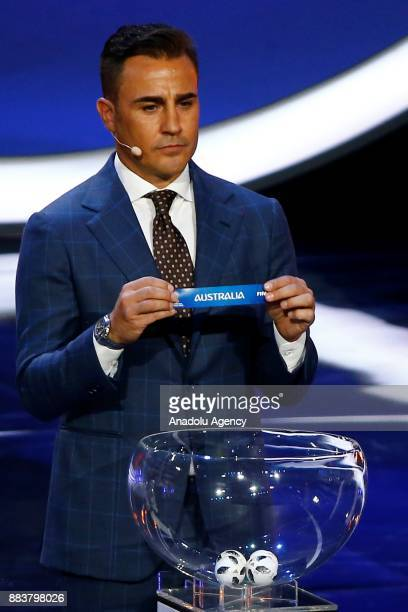 Former Italian international Fabio Cannavaro shows the ticket of Australia during the 2018 FIFA World Cup Russia Final Draw in the State Kremlin...