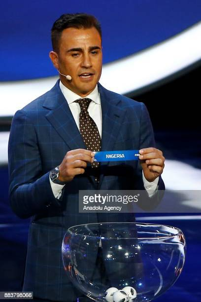 Former Italian international Fabio Cannavaro shows the ticket of Nigeria during the 2018 FIFA World Cup Russia Final Draw in the State Kremlin Palace...