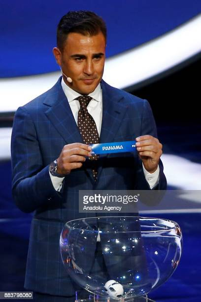 Former Italian international Fabio Cannavaro shows the ticket of Panama during the 2018 FIFA World Cup Russia Final Draw in the State Kremlin Palace...