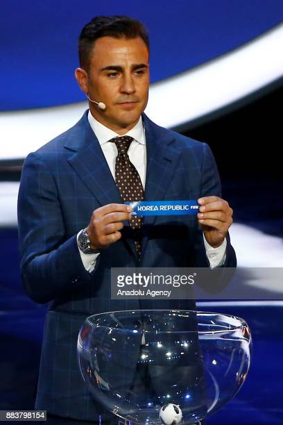 Former Italian international Fabio Cannavaro shows the ticket of South Korea during the 2018 FIFA World Cup Russia Final Draw in the State Kremlin...