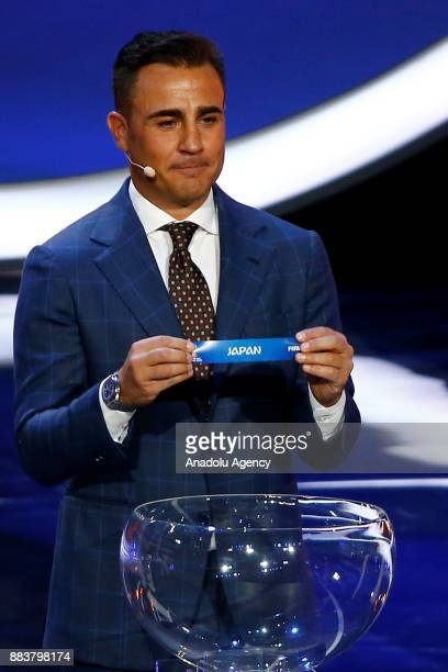 Former Italian international Fabio Cannavaro shows the ticket of Japan during the 2018 FIFA World Cup Russia Final Draw in the State Kremlin Palace...