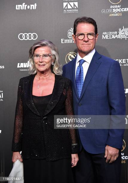 Former Italian player and team manager Fabio Capello arrives with his wife Laura Ghisi to attend the 11th edition of the Globe Soccer Awards ceremony...