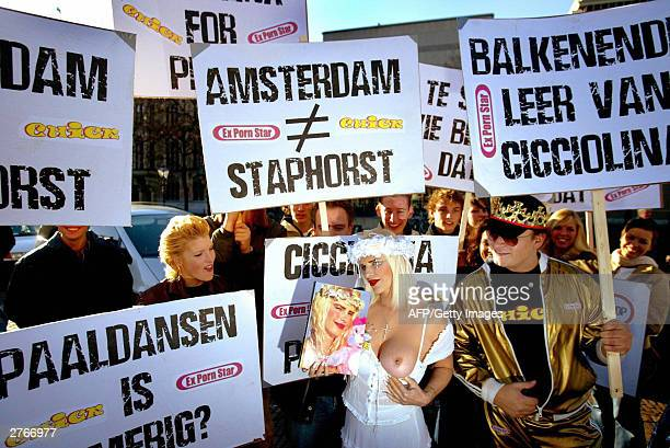 Former Italian pornstar and politician Ciccolina poses on the Plein in front of the Parlaiment in The Hague as she shows her trademark naked breast...