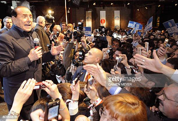 Former Italian prime minister and conservative leader Silvio Berlusconi holds an election rally called stand up party in Milan on April 7 2008...