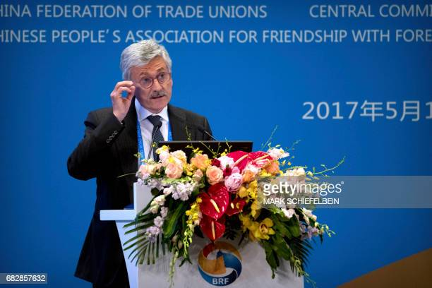 Former Italian Prime Minister Massimo D'Alema adjusts his glasses as he speaks during a session on peopletopeople connectivity of the Belt and Road...