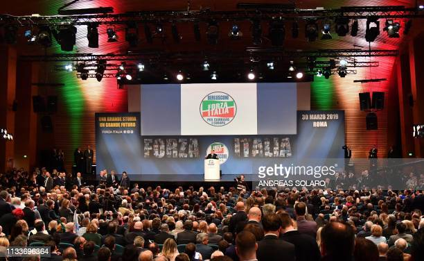 Former Italian prime minister Silvio Berlusconi addresses a rally of rightwing Forza Italia party on March 30 2019 at the Congress Center in Rome...