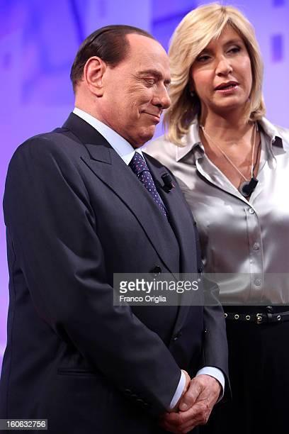 Former Italian Prime Minister Silvio Berlusconi and Tv conductor Myrta Merlino attend 'L'Aria Che Tira' TV show on February 4, 2013 in Rome, Italy....