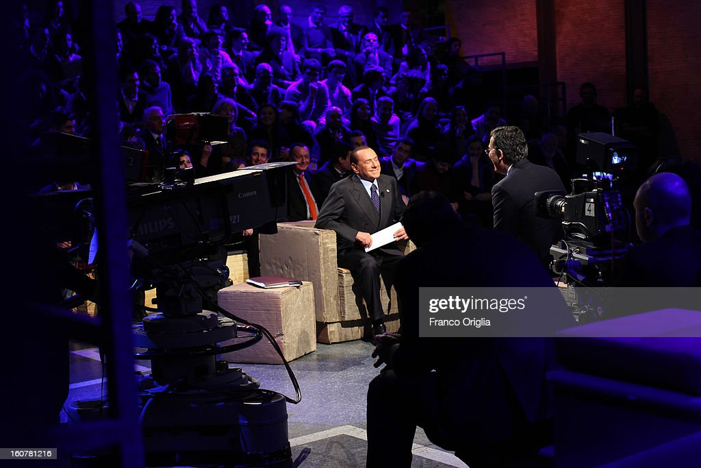 Former Italian Prime Minister Silvio Berlusconi (L) and Tv conductor Giovanni Floris (R) attend 'Ballaro' Italian TV talk show on February 5, 2013 in Rome, Italy. Silvio Berlusconi has announced on Sunday that if the PDL party (People of the Liberty) win the elections scheduled for February 24, they will return the tax to families introduced by the government of Mario Monti.