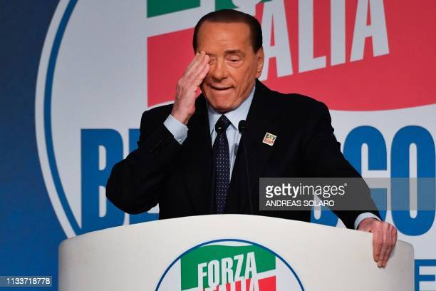 Former Italian prime minister Silvio Berlusconi gestures as he addresses a rally of rightwing Forza Italia party on March 30 2019 at the Congress...