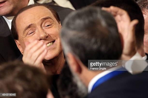Former Italian Prime Minister Silvio Berlusconi greets his supporters gathered at the Auditorium della Conciliazione during the 'Forza Silvio'...