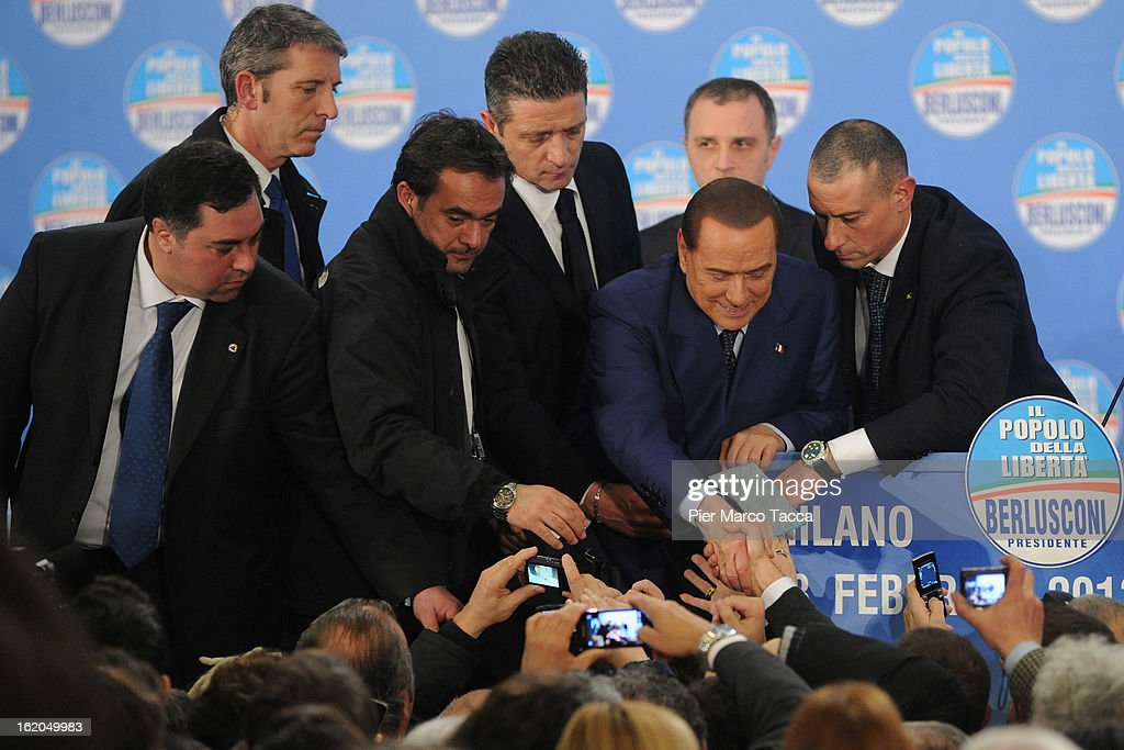 Former Italian Prime Minister Silvio Berlusconi greets supporters during a political rally on February 18, 2013 in Milan, Italy. Berlusconi is entering the last week of campaigning for his party Popolo della Liberta. Italians go to the polls February 24-25.