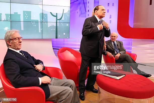 Former Italian Prime Minister Silvio Berlusconi Vittorio Feltri and Giovanni Valentini attend 'L'Aria Che Tira' TV show on February 1 2013 in Rome...