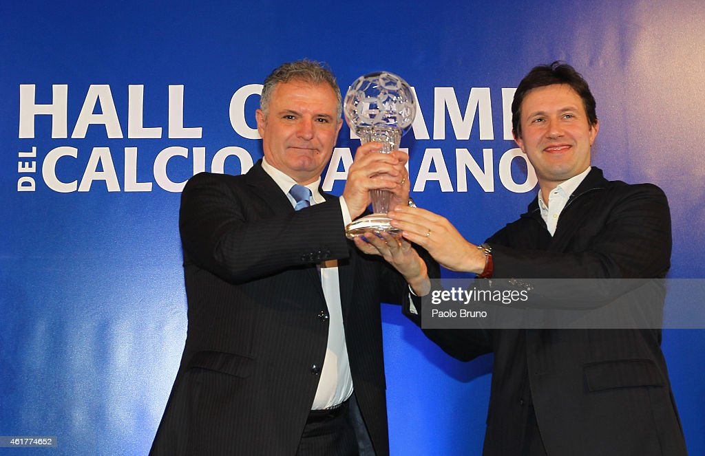 Former Italian referee Stefano Braschi and Florence Mayor Dario Nardella pose showing the award during the Italian Football Federation Hall of Fame Award ceremony at Palazzo Vecchio on January 19, 2015 in Florence, Italy.