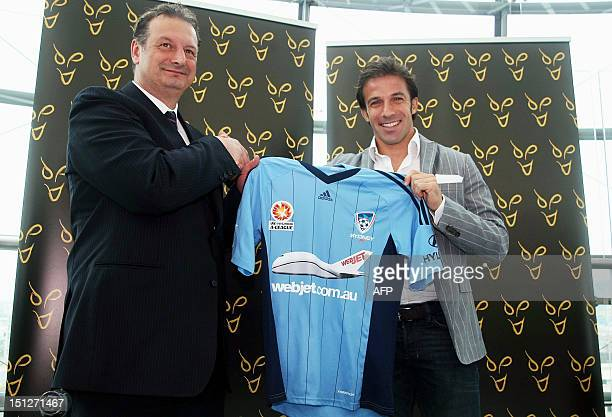 Former Italy and Juventus forward Alessandro Del Piero smiles as he poses together with Tony Pignata CEO of Sydney FC at the Lingotto Palace in Turin...
