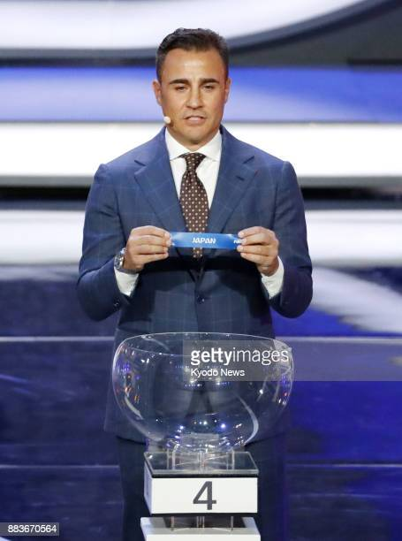 Former Italy defender Fabio Cannavaro pulls Japan's name out of the pot into Group H at the draw for the 2018 soccer World Cup finals in Moscow on...