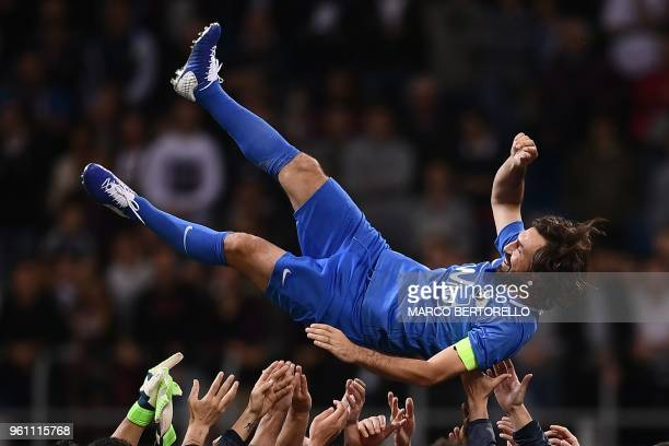 Former Italy's football player Andrea Pirlo celebrates with teammates at the end of the 'Notte del Maestro' a football match celebrating the end of...
