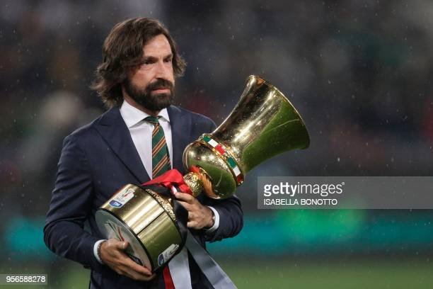 Former Italy's international player Andrea Pirlo holds the trophy before the Italian Tim Cup final Juventus vs AC Milan at the Olympic stadium on May...