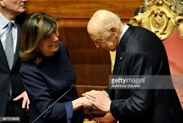 Former Italy's President Giorgio Napolitano congratulates Forza Italia senator Maria Elisabetta Alberti Casellati after she was elected Senate...