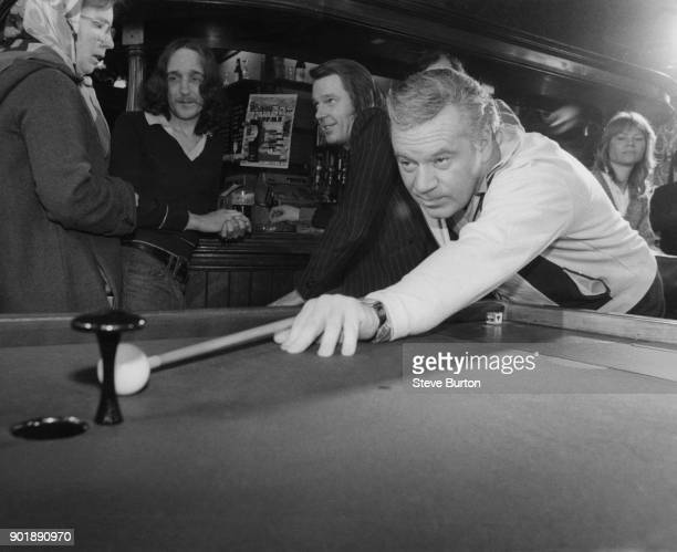 Former ITN newscaster Reginald Bosanquet plays bar billiards at the World's End pub in Chelsea London 11th January 1980 Bosanquet who is patron of...