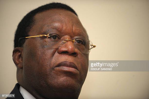 Former Ivorian Foreign Minister Youssouf Bakayoko listens to unidentified members of the electoral commission late on February 25 2010 at the...