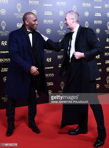Former Ivorian forward Didier Drogba and AS Monaco FC's Russian former vice president Vadim Vasilyev arrive to attend the Ballon d'Or France Football...
