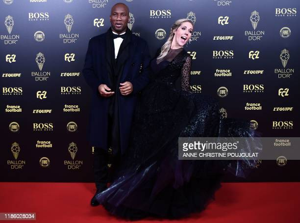 Former Ivorian forward Didier Drogba and French English tv host Sandy Heribert arrive to attend the Ballon d'Or France Football 2019 ceremony at the...