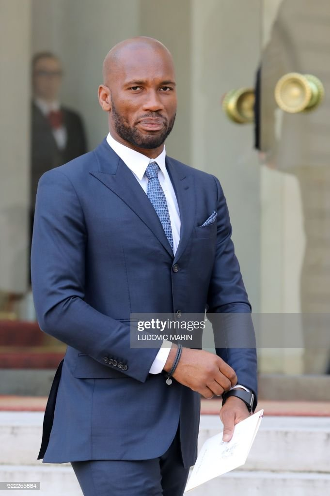 Former Ivorian international footballer Didier Drogba poses as he leaves at The Elysee Palace in Paris on February 21, 2018, after attending a lunch function given for Liberian President George Weah. /