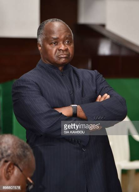 Former Ivorian minister for labour and public service Hubert Oulaye accused of complicity in the assassination of UN soldiers reacts after hearing...
