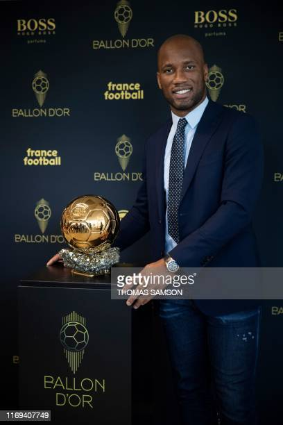 Former Ivory Coast international football player Didier Drogba and ambassador for the 2019 edition of the Ballon d'Or poses with the trophy during...